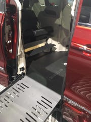 The ramp in a 2019 Chrysler Pacifica that has been converted for wheelchair accessibility is on display at the 2019 North American International Auto Show at Cobo Center in Detroit, Michigan, on Jan. 16, 2019.