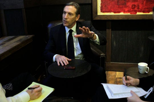 In this Dec. 16 2010 photo, Starbucks CEO Howard Schultz is interviewed by The Associated Press at a Starbucks coffee shop in the Soho neighborhood of New York. Schultz said recently he may run for president of the U.S. as an independent. (AP Photo/Mary Altaffer, File)