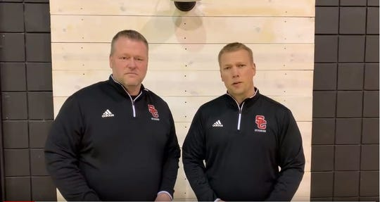 Swartz Creek Community Schools high school principal Jim Kitchen (left) and superintendent Ben Mainka sing a song to announce Tuesday's snow day. A video was posted on YouTube Monday.