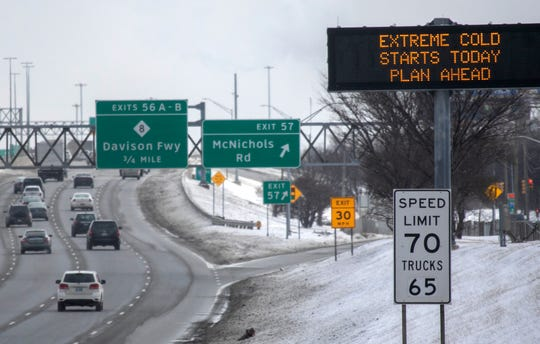 An MDOT sign along I-75 southbound just north of McNichols offers a public service announcement warning motorists of the extreme frigid temperatures approaching Michigan Tuesday Jan. 29, 2019.