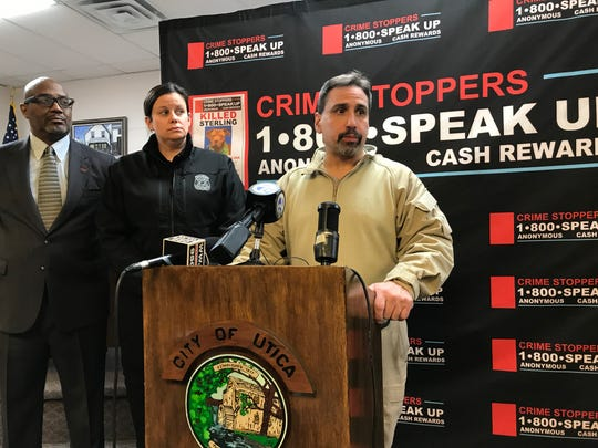 Anthony Jones with Crime Stoppers of Michigan, left; Elise Ramsey, a cruelty investigator with the Michigan Humane Society, and Utica Police Det. Sgt. Greg Morabito discuss the violent slaying of an adopted dog, Sterling, whose body was found in Grant Park in Utica on Jan. 24, 2019.