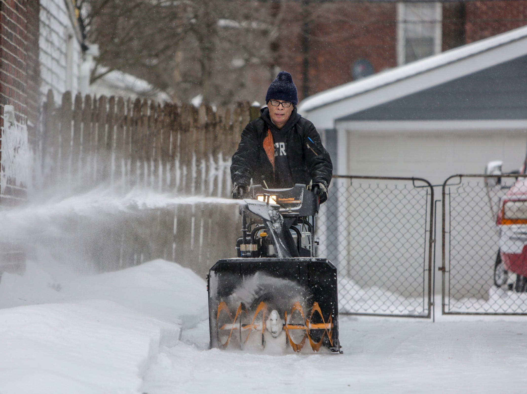 On the eve of the Polar Vortex, Marion Sims, 72, of Detroit clears the snow from the walkways and driveway in front of his home on Tuesday, Jan. 29, 2019. Some areas of Lower Michigan could face wind chills as low as 45 degrees below zero, according to the National Weather Service.