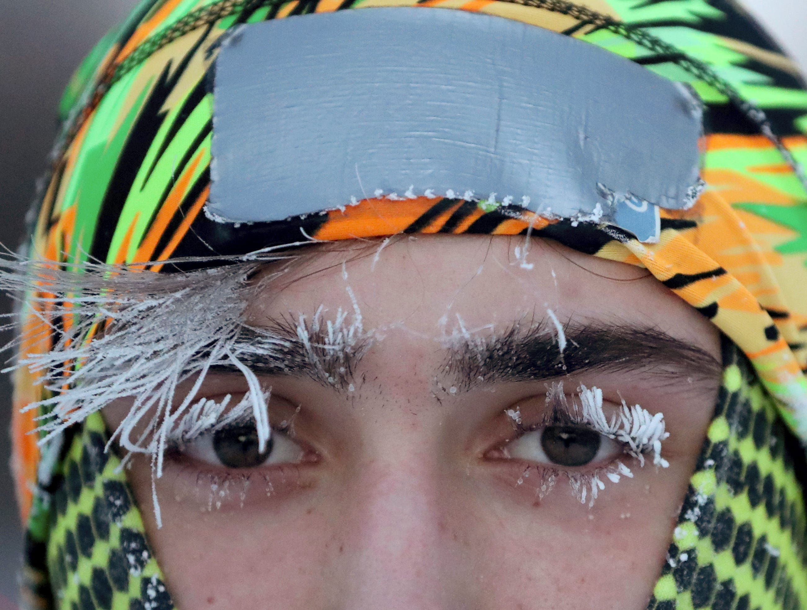 Frost covers part of the face of University of Minnesota student Daniel Dylla during a morning jog along the Mississippi River Parkway on Tuesday, Jan. 29, 2019, in Minneapolis. Forecasters warn that the frigid weather could be life-threatening.