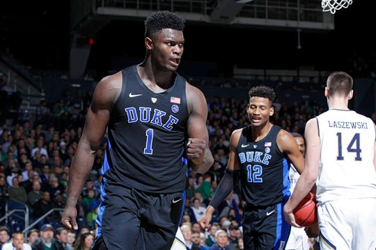 Zion Williamson of the Duke Blue Devils reacts after scoring a basket and drawing a foul against the Notre Dame Fighting Irish in the second half Monday. No. 2 Duke won 83-61.