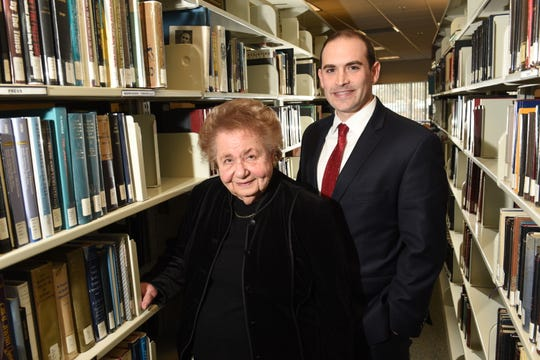 Clara Garbon-Rednoti, a Holocaust survivor,  with attorney Jonathan H. Schwartz in the library of the Holocaust Memorial Museum Center's Zekelman Family Campus in Farmington Hills on Thursday, January 10, 2019.