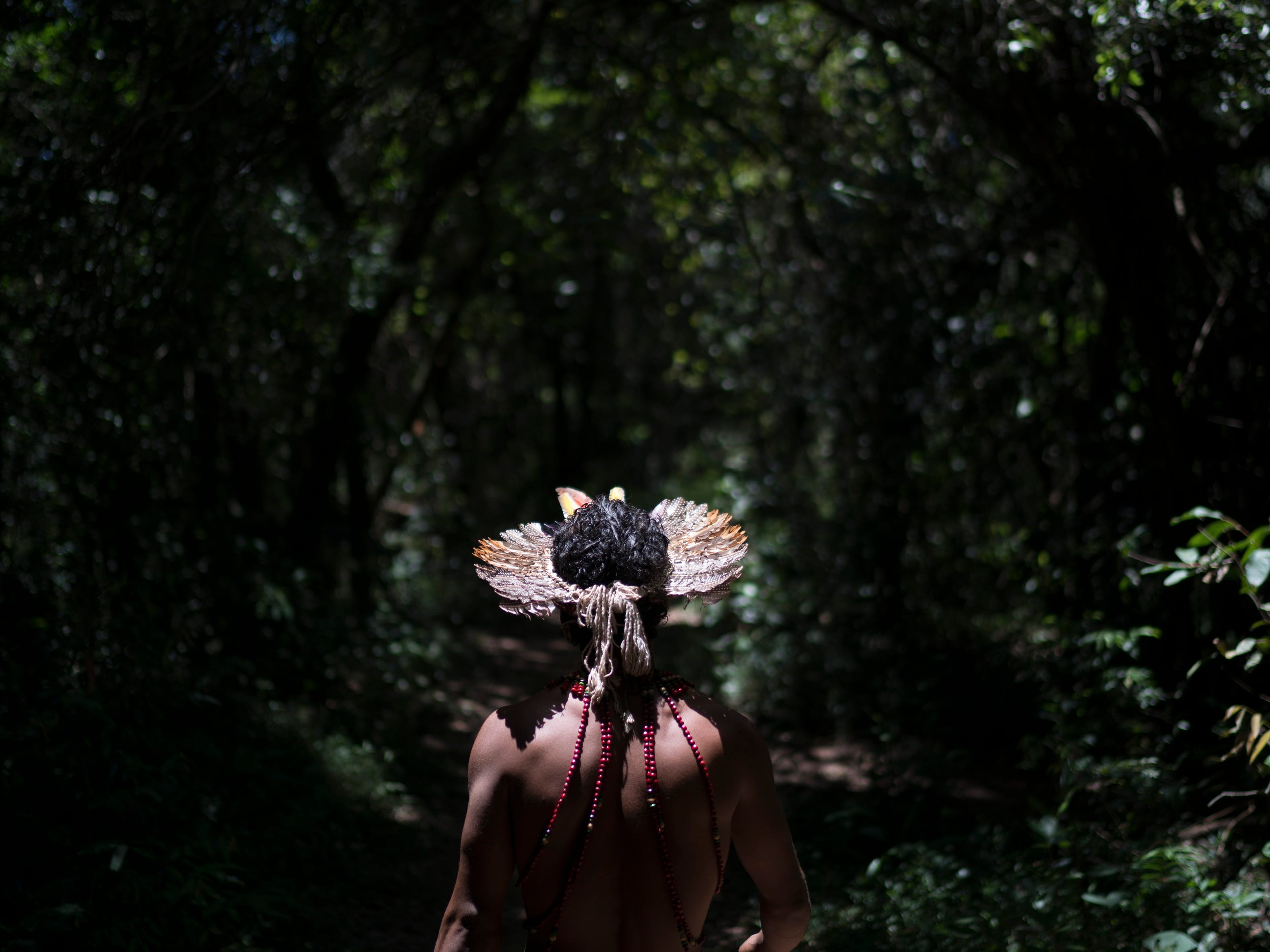 Hayo, chief of the Pataxo Ha-ha-hae indigenous community, walks toward the Paraopeba River days after the collapse of a mining company dam, near his village in Brumadinho, Brazil, Tuesday, Jan. 29, 2019. Mining giant Vale representatives insisted that the mud is composed mostly of silica, or sand, and is non-toxic, but environmental groups contend the iron ore mine waste contains high levels of iron oxide that could cause irreversible damage.