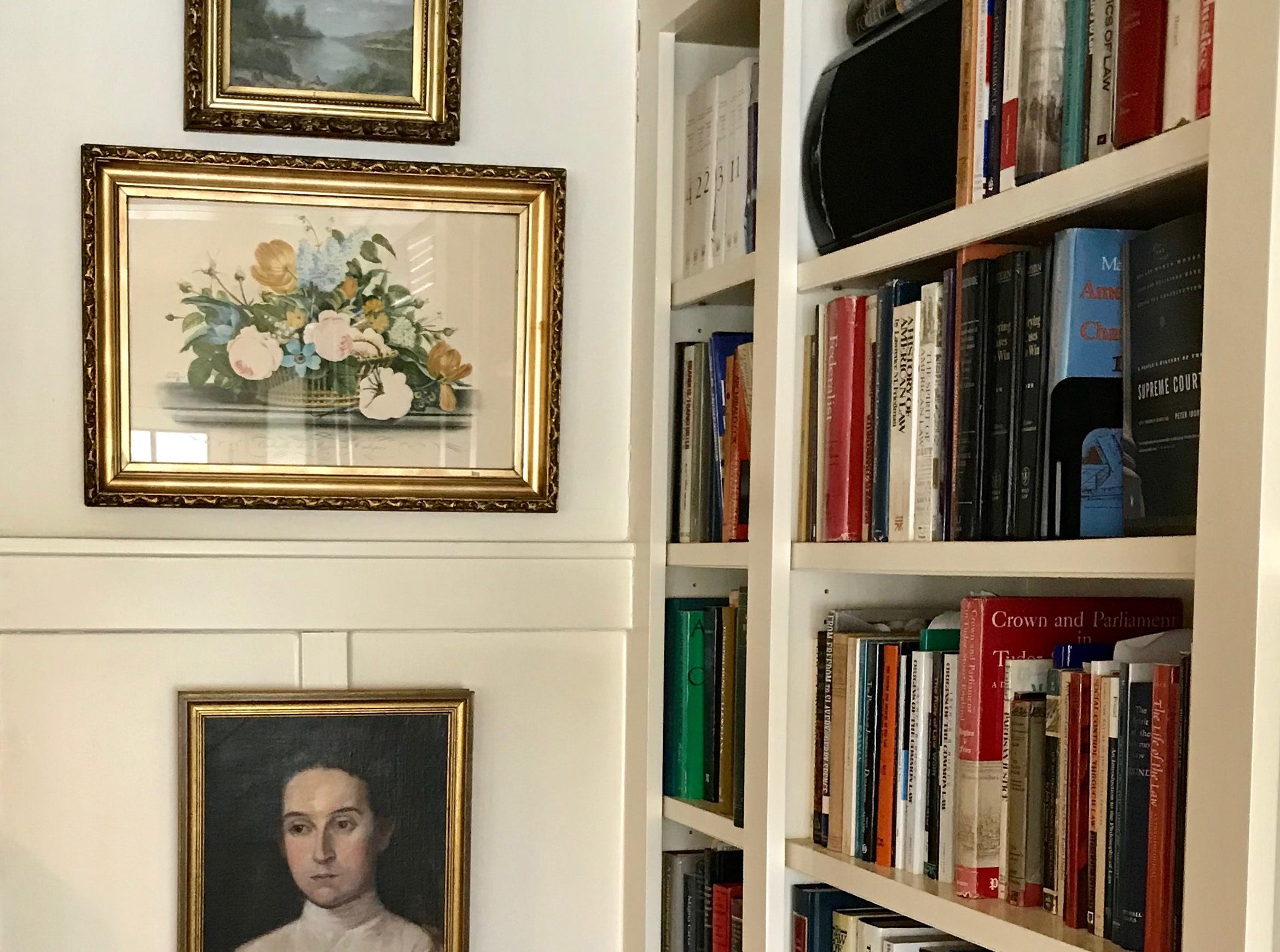 "Essential bookcases: Garrity has called bookcases one of the most ""essential pieces of furniture ever made."" But they don't have to be used for books. ""My all-time favorite way to use bookcases is to see them as part library shelf, part display shelf,"" writes Garrity. ""We like to mix accents, like pottery, seasonal greens and artwork, with stacks of books. Have a small piece of artwork you love? Prop it in an easel on a shelf."""