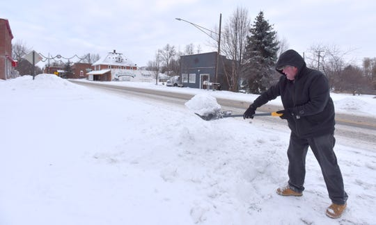 Mike Brandes, of Berville in St. Clair County, shovels out his driveway near the end of North Avenue so he can go to work on Tuesday morning. Michigan could see record-breaking lows this weekas temperatures plummet and arctic winds bring the windchill possibly down to minus 40 degrees.