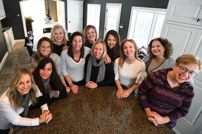 Members of Phoemale, from left, Sarah Peruski, Missy Kinyon, Lanna Young, Jill Richter, Jenelle Lefief, Ally Hathaway, Jamie Baker, Lisa Kvintus, Lynn Walsh, Christina Buchanan and Nancy Derringer, help women who may have suffered abuse, homelessness or other situations.