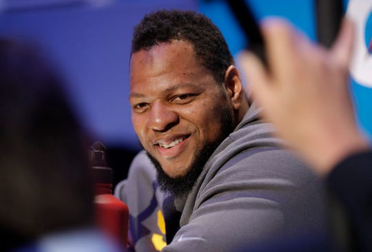 Former Lions defensive lineman Ndamukong Suh smiles during Opening Night for Super Bowl 53 on Monday in Atlanta.