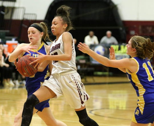 Jalea Abrams of Elmira drives toward the basket as Maine-Endwell's Ashlynn McKnight, left, and Meredith Rose defend Jan. 28, 2019 at Elmira High School.