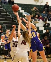 Amanda DeSantis of Maine-Endwell puts up a shot as Elmira's MacKenna Bruner (14) and Tess Arnold (23) defend Jan. 28, 2019 at Elmira High School.