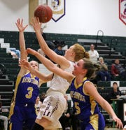 Caylee Boorse of Elmira goes up for a layup as Maine-Endwell's Sophia Pelton (3) and Allison L'Amoreaux (5) defend Jan. 28, 2019 at Elmira High School.