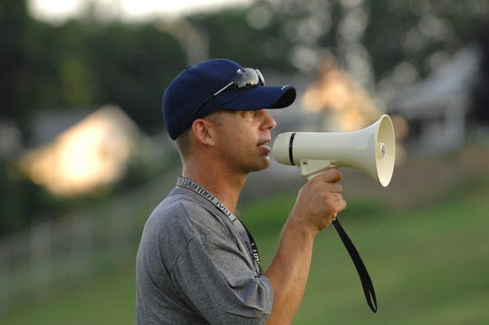 Then-Reitz head coach Tony Lewis shouts instructions on the practice field during first day of high school football practice in 2008.