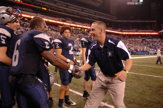 Reitz senior Alordo Bell is congratulated by then-Reitz coach Tony Lewis after their State Championship victory in 2009. Lewis was named the head coach at jasper on Monday.