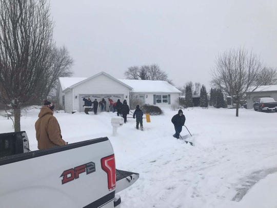 Several Lomira wrestlers spent their snow day together shoveling residents' driveways.
