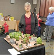 Clyde VFW Auxiliary member Ruth Wise displays her post's entry in a recent contest.