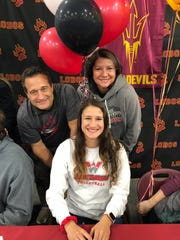 Myles Hilbert, center, poses for a picture with her father, Tom, and mother, Leslie Taylor, at a signing day ceremony Nov. 14, 2018, at Rocky Mountain High School. Myles Hilbert signed a letter of intent to play volleyball and compete in track and field at Colorado Western University in Gunnison.