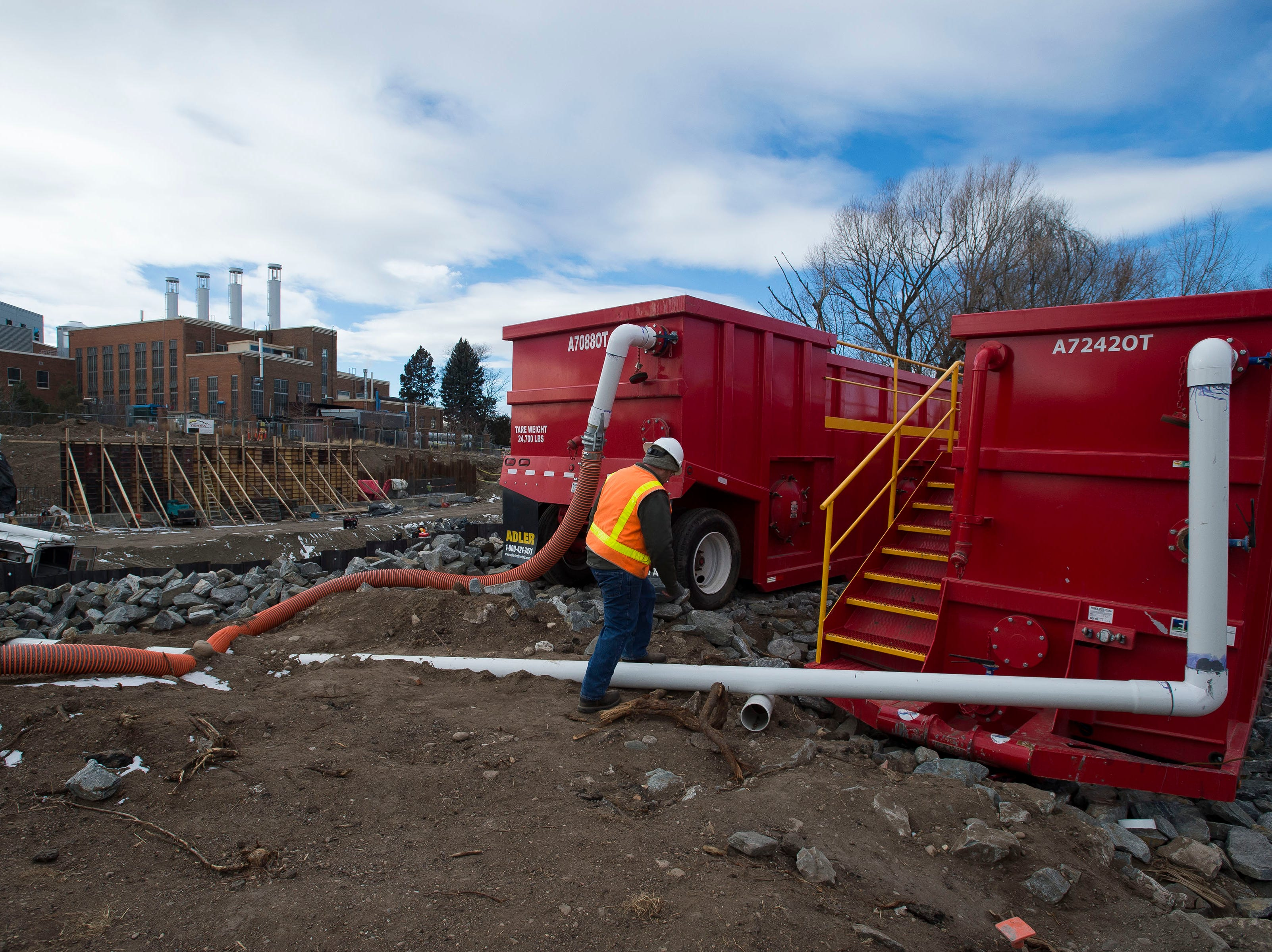 Senior landscape architect for the city of Fort Collins Matt Day walks up to the onsite water treatment tanks on Wednesday, Jan. 23, 2019, on the Cache la Poudre River, just South of North College Avenue in Fort Collins, Colo.