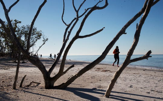 A runner heads north on Fort Myers Beach last month. Climate educators with The CLEO Institute in Miami say the number of days with temperatures above 90 degrees has risen since the 1970s.