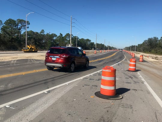 A driver going left of center along state Road 82 near Daniels Parkway was the cause of Monday morning's double fatal crash, the Florida Highway Patrol said.