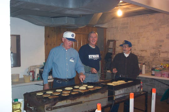 Northern Door County Kiwanis Club members make pancakes during a recent Sister Bay Fall Festival.