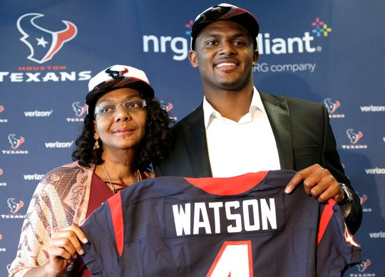 In this April 28, 2017, file photo, Houston Texans quarterback Deshaun Watson, right, poses with his mother Deann after an NFL football news conference in Houston. Watson's mother spent years encouraging him to chase his dreams. He has achieved one of his biggest goals of reaching the NFL. Now the Texans quarterback is giving back by renovating the home he grew up in and surprising his mom.