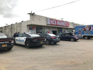 Guam Police Department officers parked outside NCS Market on Friday, Jan. 29, 2019. Police were looking into a video circulating social media showing an individual hit by a car. The incident didn't happen recently, according to Sgt. Paul Tapao, GPD spokesman.