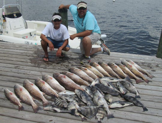 Captain Sonny Schindler and his wife, Stephanie, and a catch of fish using bait of blue crabs.