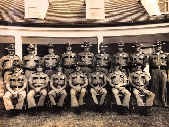 Troopers pose in front of the then-new Kentucky State Police post on U.S. 41-North in about 1960. Among those pictured are troopers Mack Brade (standing, fourth from right), who was the father of Henderson County Sheriff Ed Brady, and longtime trooper Forrest Teer (seated, second from left).