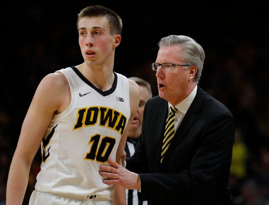 Joe Wieskamp, left, probably won't play in college for four years, coach Fran McCaffery predicted.