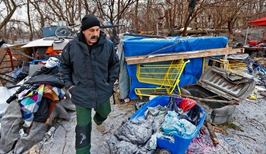IMPD homeless unit patrolman Pat McPherson checks for homeless near Downtown on Jan. 29, 2019.