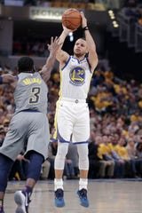 Golden State Warriors guard Stephen Curry (30) shoots over Indiana Pacers guard Aaron Holiday (3) during the first half of an NBA basketball game in Indianapolis, Monday, Jan. 28, 2019.
