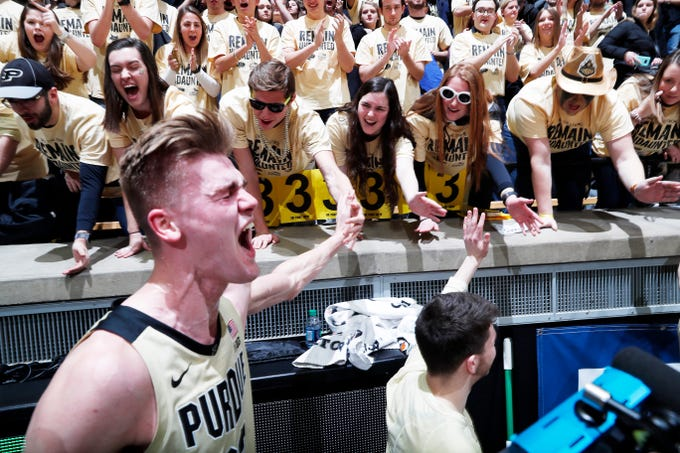 Jan 27, 2019; West Lafayette, IN, USA; Purdue Boilermakers center Matt Haarms (32) celebrates with fans in the stands after defeating the Michigan State Spartans at Mackey Arena.