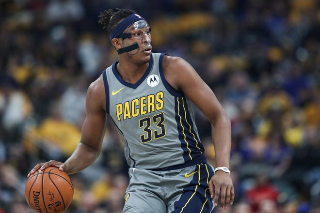 Indiana Pacers center Myles Turner (33) certainly isn't upset that it's time to let the mask go.