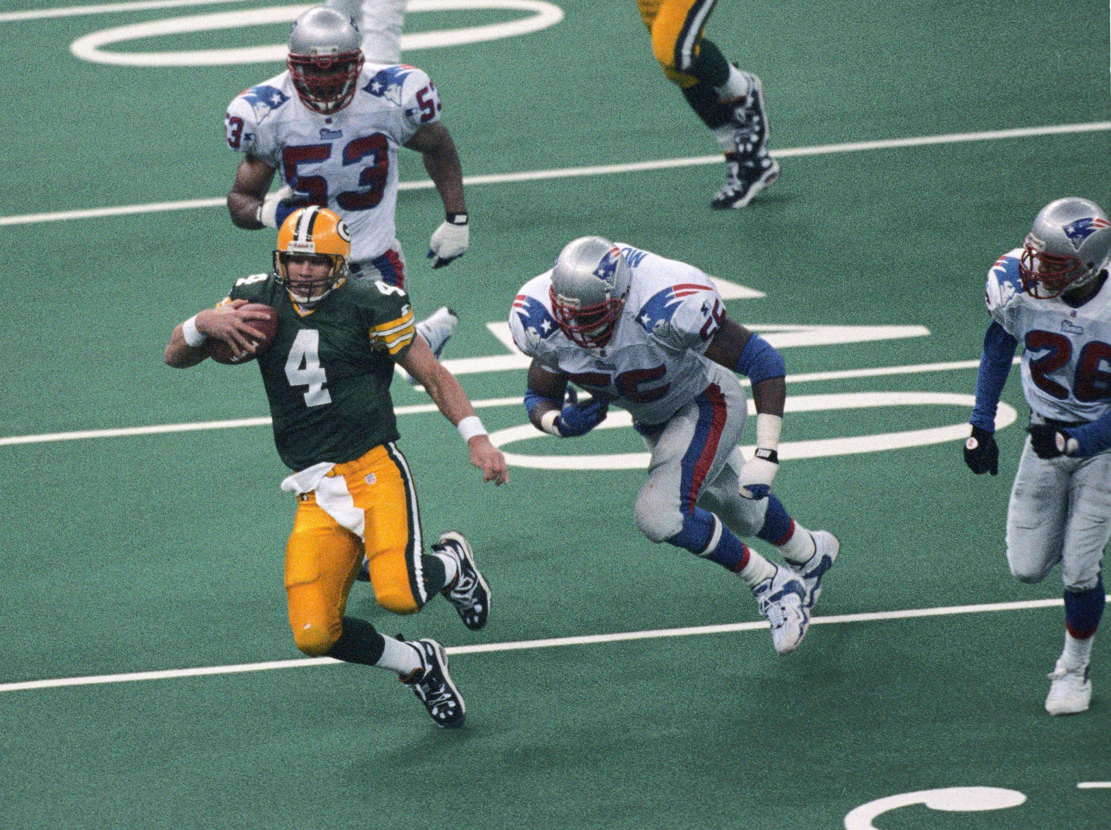 In 1996, the Green Bay Packers were led by Hall of Fame QB Brett Favre to their first championship win in almost 30 years. The team had the best offense, defense and special teams in the league that year. They defeated the New England Patriots in Super Bowl XXXI 35-21. The NFC had won the championship 12 years in a row by this point but a new era was about to start. (pictured: Jan 26, 1997; New Orleans, LA, USA; Green Bay Packers quarterback Brett Favre (4) in action against New England Patriots defensive end Willie McGinest (55) and linebacker Chris Slade (53) during Super Bowl XXXI at the Superdome.)
