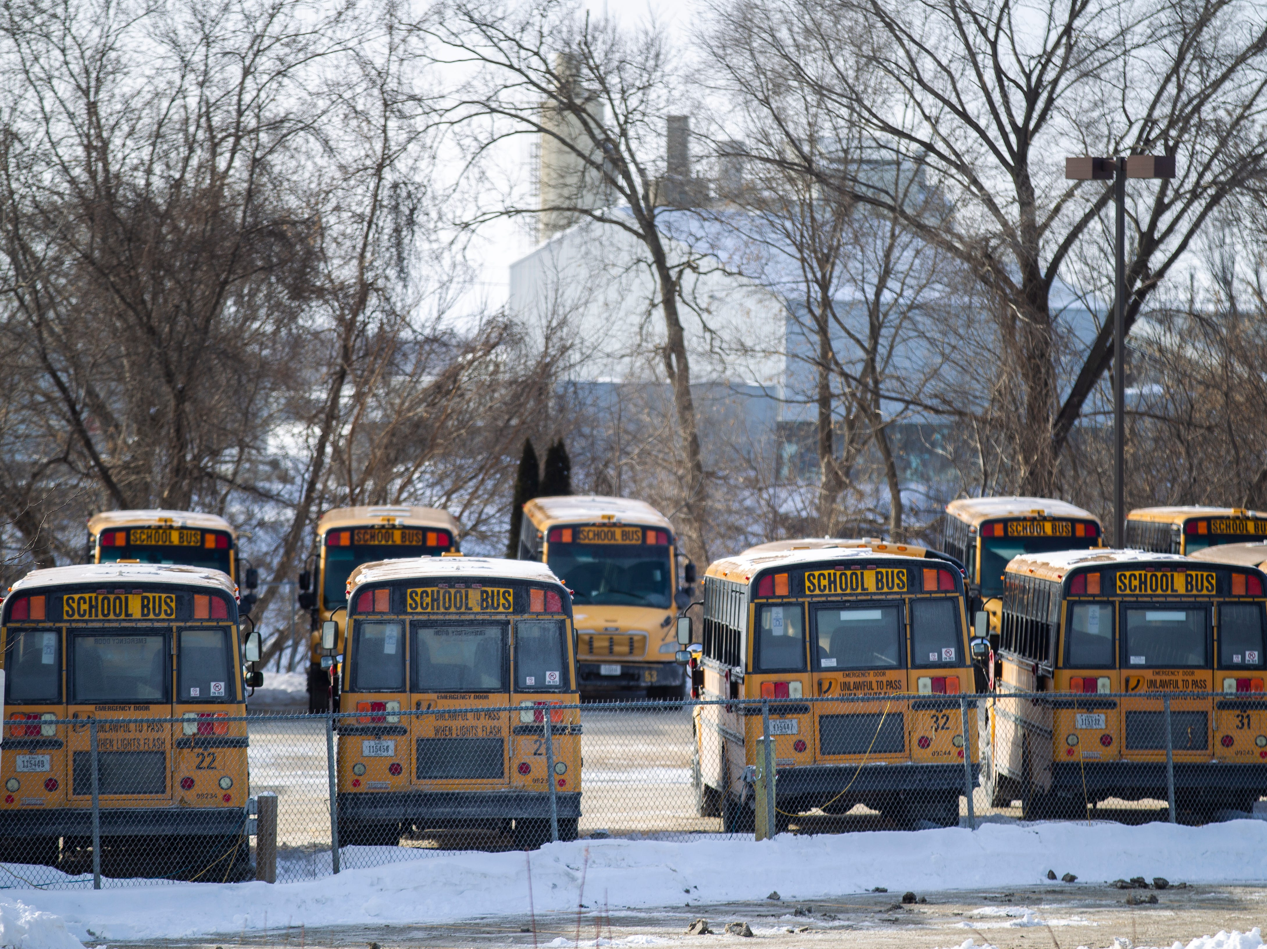 Iowa City Community School District busses are seen on Tuesday, Jan. 29, 2019, at Durham School Services in Iowa City, Iowa. School was canceled Tuesday, Wednesday and Thursday due to extreme cold.