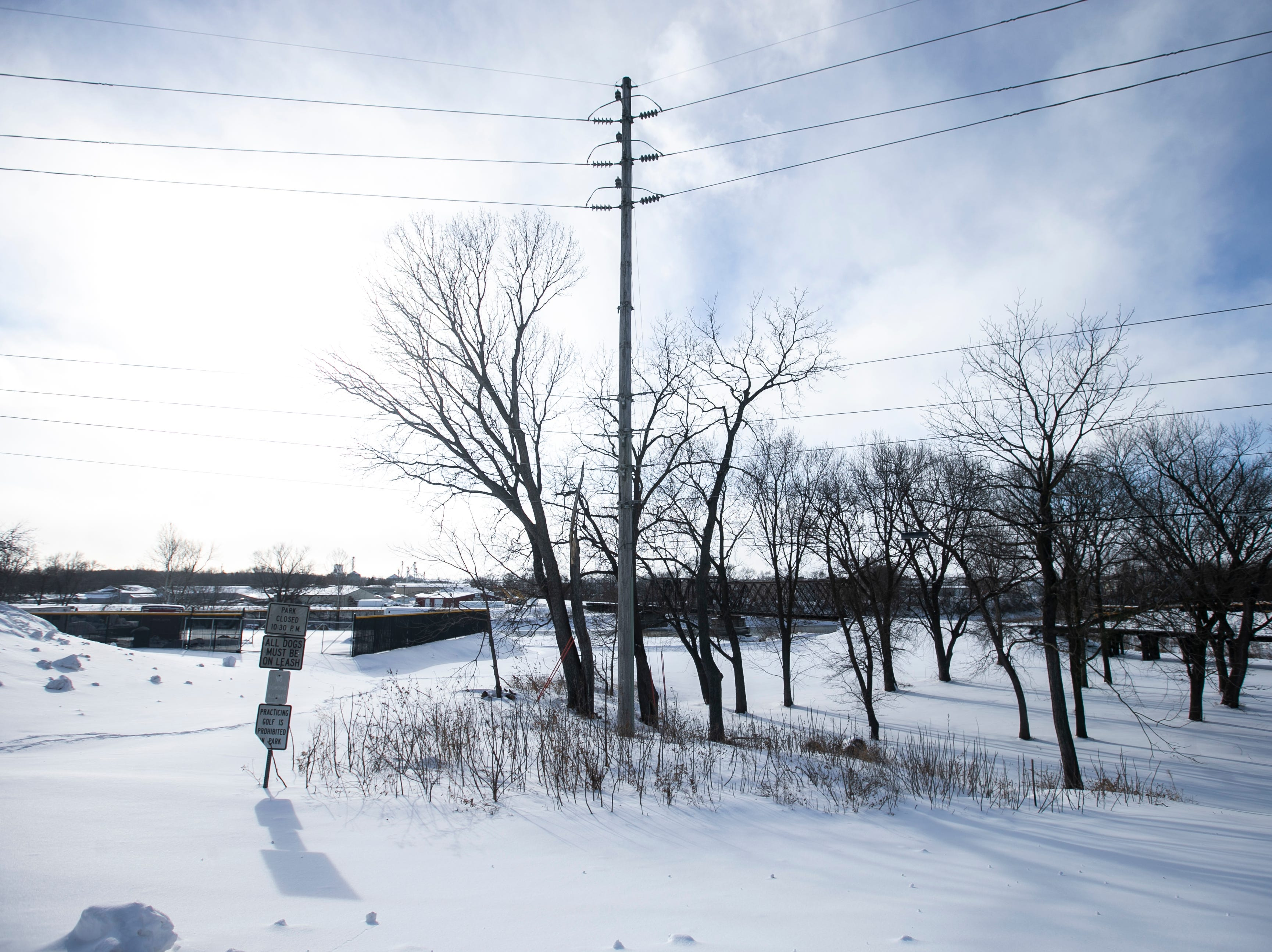 Wind gusts along South Gilbert Street on Tuesday, Jan. 29, 2019, near Napoleon Park in Iowa City, Iowa. Air temperatures are forecasted to plummet more than 30 degrees below zero on Wednesday.