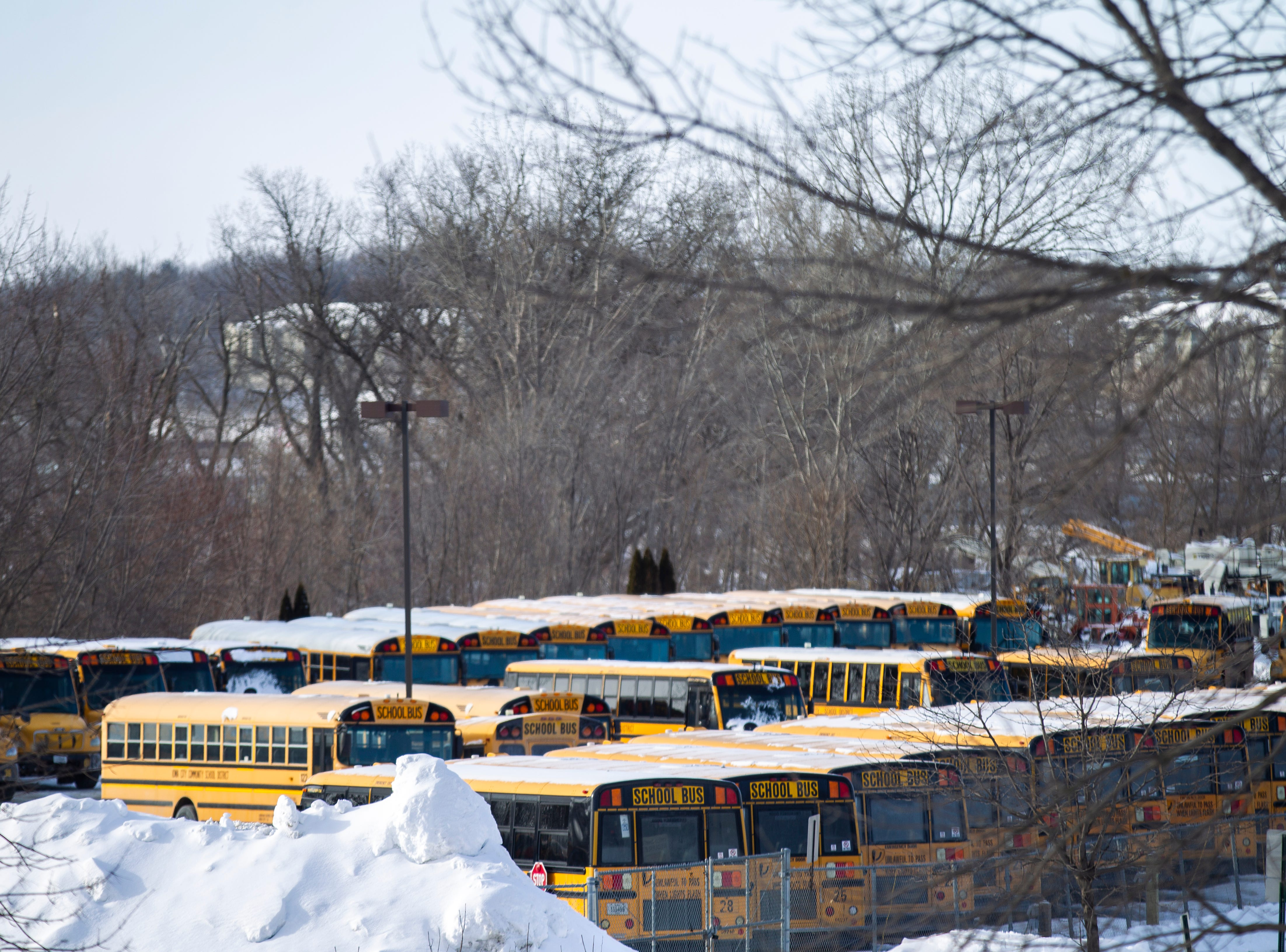 Iowa City Community School District busses are seen on Tuesday, Jan. 29, 2019, at Durham School Services in Iowa City, Iowa.