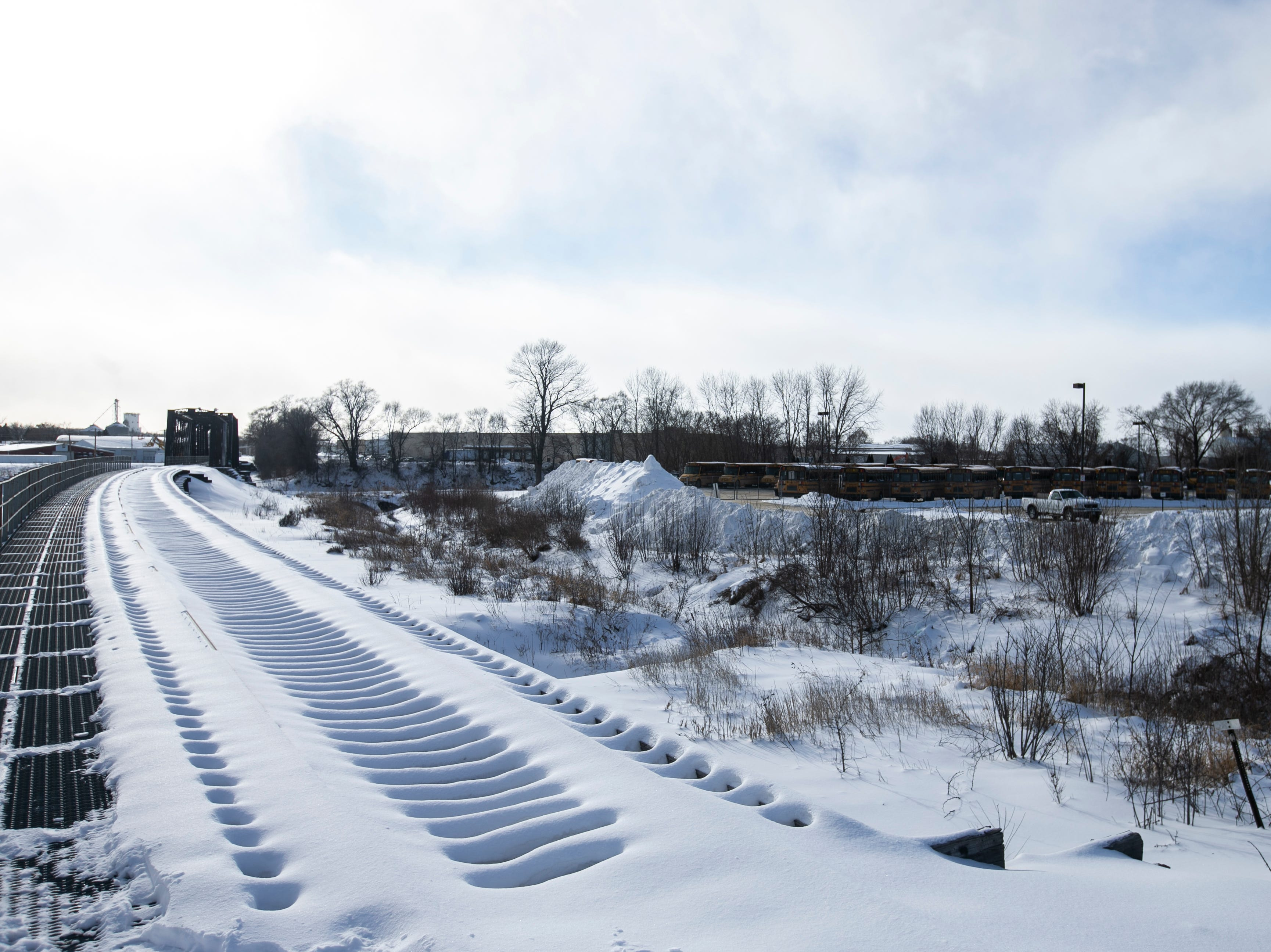 Train tracks run past Iowa City Community School District busses parked on Tuesday, Jan. 29, 2019, at Durham School Services in Iowa City, Iowa. School was canceled Tuesday, Wednesday and Thursday due to extreme cold.