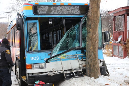 A bus sustained front end damage following a crash with a car and a tree at the corner of Green Steet and Meadow Street.