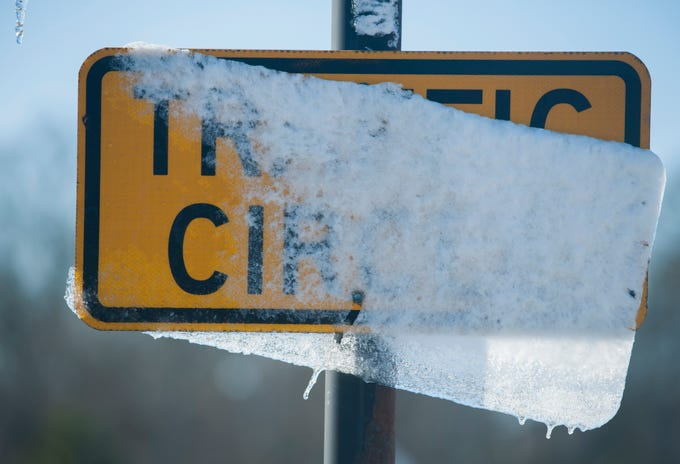 Melting snow on traffic signs in Madison, Miss., along with freezing temperatures, are all that remain Tuesday, Jan. 29, 2019, after cold front moved through state leaving the Jackson metro area with less than an inch of snow.