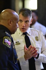 Byram police chief Luke Thompson (right) speaks with Natchez police chief Walter Armstrong (left) speak in a hall of the capitol in Jackson in a 2019 file photo.