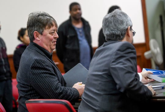 Defense attorney Colin Morris speaks with Assistant District Attorney Mike Mosier at the arraignment for John David Robison at Jackson City Court in Jackson, Tenn., on Tuesday, Jan. 29, 2019.