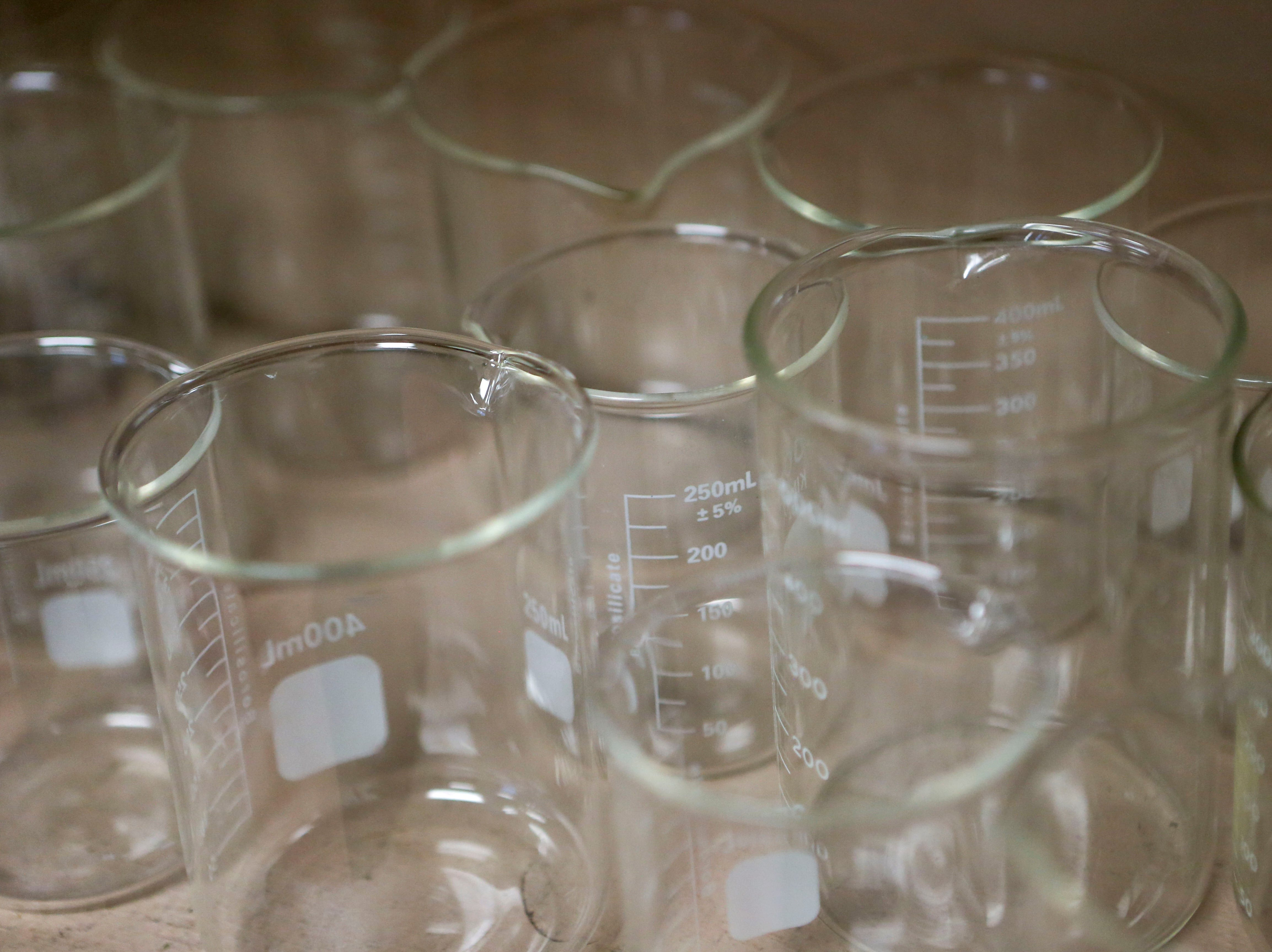 Beakers line the surface of a shelf in a science classroom at Jackson Central-Merry in Jackson, Tenn., on Tuesday, Jan. 29, 2019.