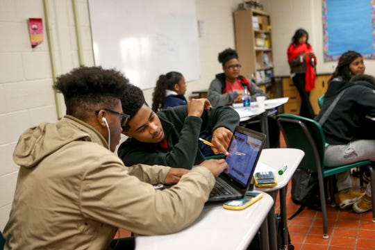 Ceterrius Curry, 17, right, points to on screen instructions during online work with Jeramiah Carter, 17, left, during a science class at Jackson Central-Merry in Jackson, Tenn., on Tuesday, Jan. 29, 2019.