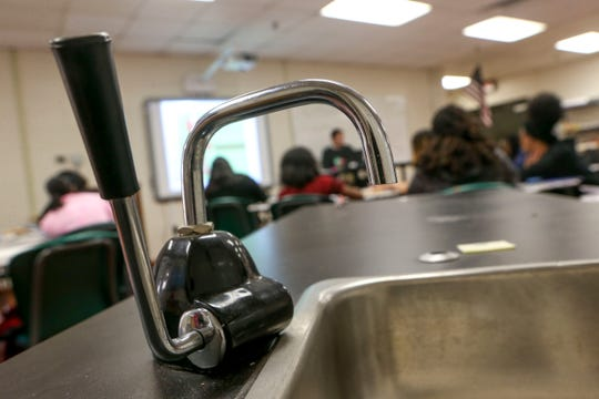 An old sink attached to a table on wheels can be seen in the science classroom behind students at Jackson Central-Merry in Jackson, Tenn., on Tuesday, Jan. 29, 2019.