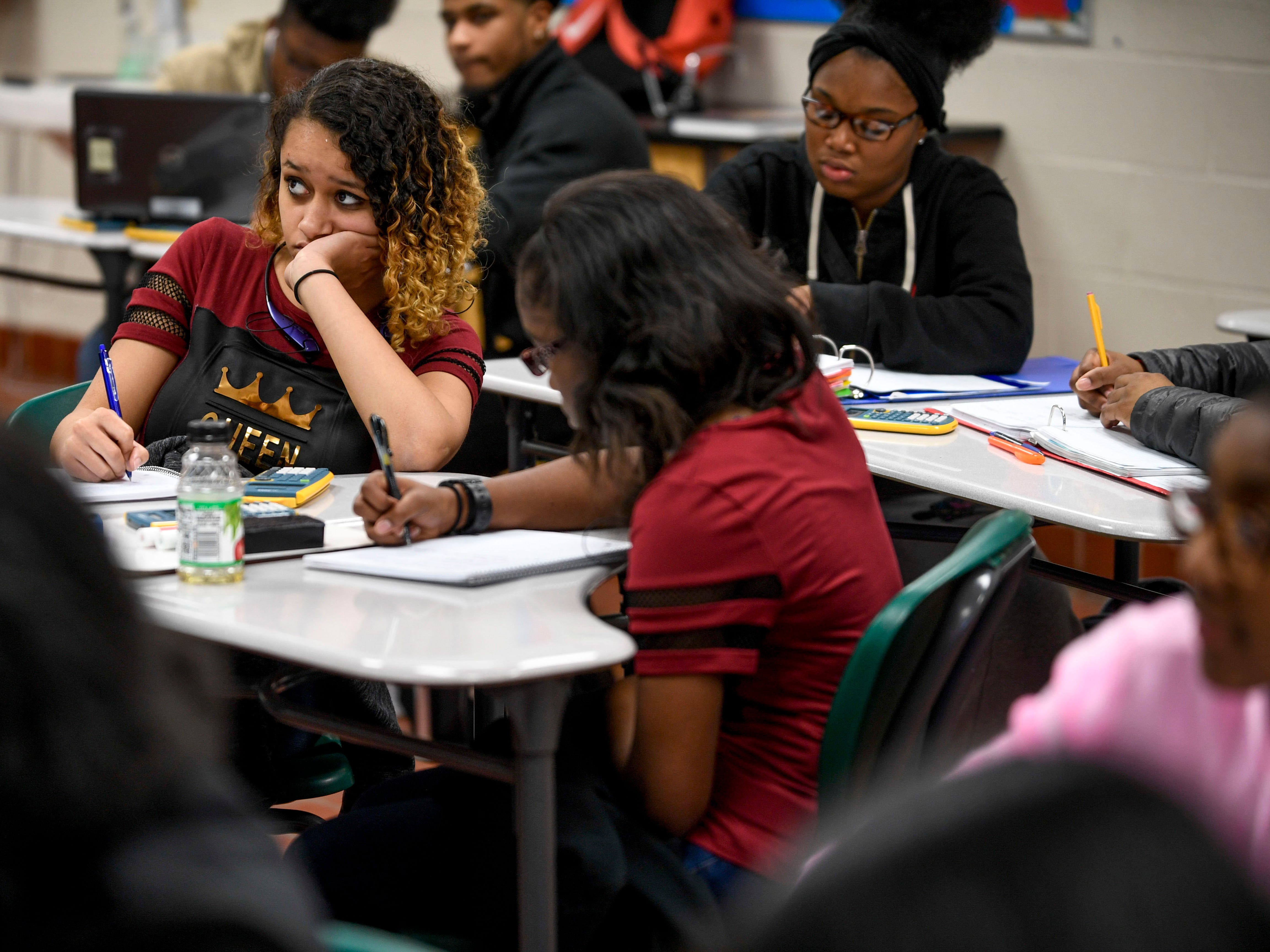 Maya Snyder, 16, jots down notes while listening to her teacher during a science class at Jackson Central-Merry in Jackson, Tenn., on Tuesday, Jan. 29, 2019.