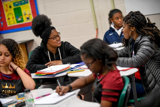 Kiya Lancaster, 17, left, jokes around with her friend Brooklyn Phillips, 16, right, during a science class at Jackson Central-Merry in Jackson, Tenn., on Tuesday, Jan. 29, 2019.