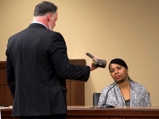 Alleged victim Kimberly Houston watches as Assistant District Attorney General David Pollard shows a rubber mallet during Kenneth Bartley's trial at Campbell County Criminal Court in Jacksboro, Tenn., on Tuesday, January 29, 2019.